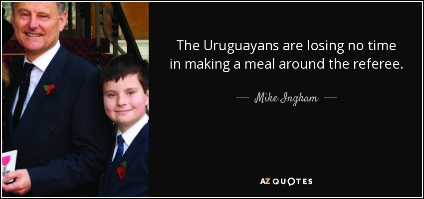 The Uruguayans are losing no time in making a meal around the referee. - Mike Ingham